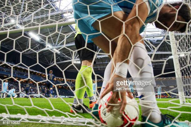 A player of FK eljezniar picks the ball from the net during the UEFA Europa League qualifying match between AIK and FK Zeljeznicar at Friends arena...