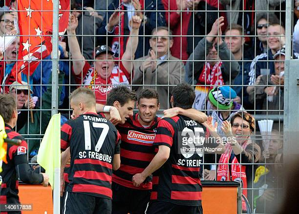 Player of Freiburg celebrates after Sebastian Freis is scoring his teams first goal during the Bundesliga match between SC Freiburg and FC Schalke 04...