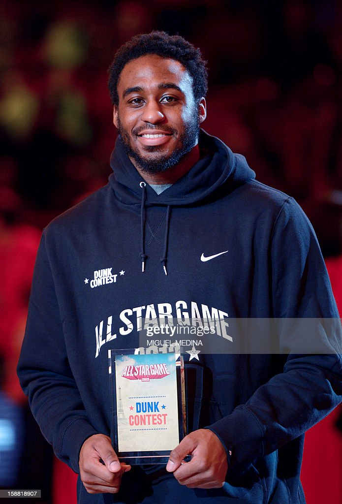 US player of French team JL Bourg-en-Bresse, L.D. Williams, jubilates as he presents his trophy after winning the dunk challenge during the France's national basketball league (LNB) 2012 All Star Game on December 30, 2012 at the Palais Omnisport de Paris-Bercy (POPB) in Paris. AFP PHOTO MIGUEL MEDINA