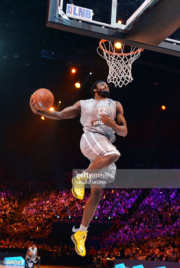 US player of French team JL Bourg-en-Bresse, L.D. Williams, jumps and won the dunk challenge during the France's national basketball league (LNB) 2012 All Star Game on December 30, 2012 at the Palais Omnisport de Paris-Bercy (POPB) in Paris. AFP PHOTO MIGUEL MEDINA