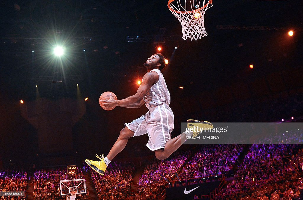 US player of French team JL Bourg-en-Bresse, L.D. Williams, jumps to score and wins the dunk challenge during the France's national basketball league (LNB) 2012 All Star Game on December 30, 2012 at the Palais Omnisport de Paris-Bercy (POPB) in Paris.