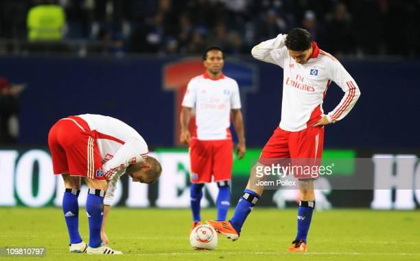 Player of Hamburg are seen after Florian Heller of Mainz scored his team's fourth goal during the Bundesliga match between Hamburger SV and FSV Mainz...