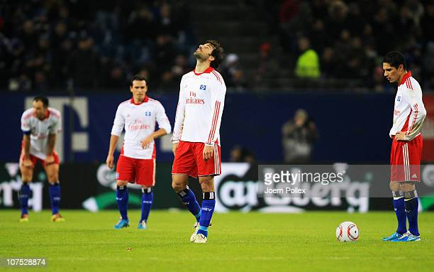 Player of Hamburg are seen after Leverkusens fourth goal during the Bundesliga match between Hamburger SV and Bayer Leverkusen at Imtech Arena on...