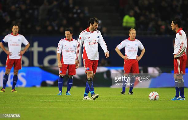 Player of Hamburg are seen after Leverkusens third goal during the Bundesliga match between Hamburger SV and Bayer Leverkusen at Imtech Arena on...