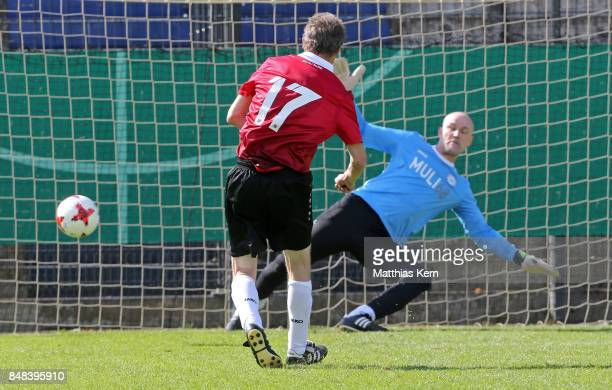 A player of Hannover 96 shoots a penalty during the half final match between SpVg Blau Weiss 1890 and Hannover 96 during the DFB over 40 and 50 cup...