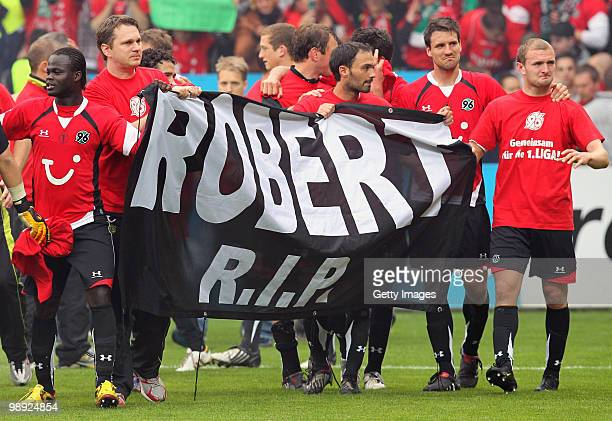 Player of Hannover celebrate and remain goalkeeper Robert Enke after the Bundesliga match between VfL Bochum and Hannover 96 at Rewirpower Stadium on...