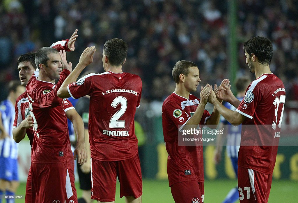 Player of Kaiserslautern celebrates after winning the DFB Cup 2nd round match between 1.FC Kaiserslautern and Hertha BSC Berlin at Fritz-Walter-Stadion on September 25, 2013 in Kaiserslautern, Germany.