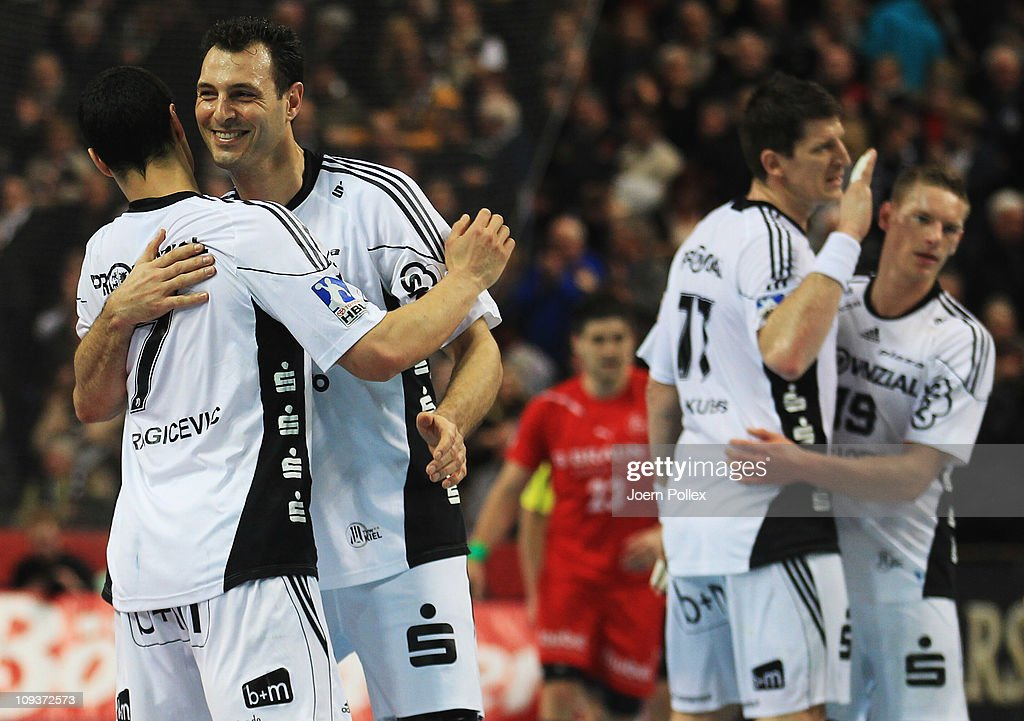 Player of Kiel celebrate after winning the Toyota Handball Bundesliga match between THW Kiel and MT Melsungen at the Sparkassen Arena on February 23, 2011 in Kiel, Germany.