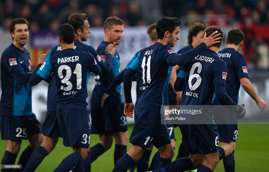 Player of Mainz celebrate after Ivan Klasnic (C) scored their first goal during the Bundesliga match between Fortuna Duesseldorf 1895 and 1. FSV Mainz 05 at Esprit-Arena on March 3, 2013 in Duesseldorf, Germany.