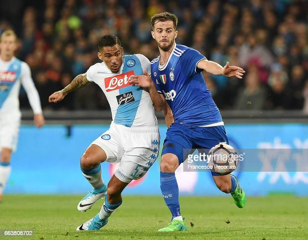 Player of Napoli Allan vies with Juventus FC player Miralem Pjanic during the Serie A match between SSC Napoli and Juventus FC at Stadio San Paolo on...