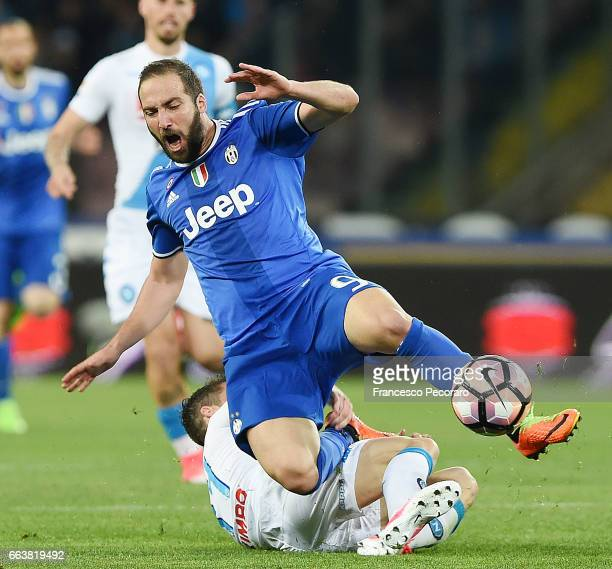 Player of Napoli Dries Mertens vies with Juventus FC player Gonzalo Higuain during the Serie A match between SSC Napoli and Juventus FC at Stadio San...