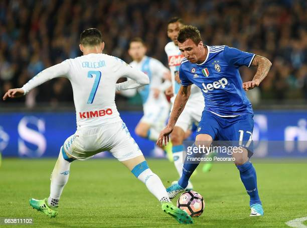 Player of Napoli Jose Callejon vies with Juventus FC player Mario Mandzukic during the Serie A match between SSC Napoli and Juventus FC at Stadio San...