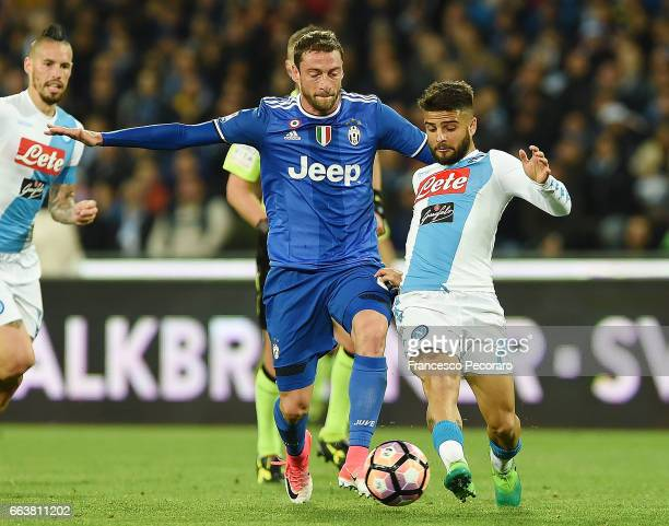 Player of Napoli Lorenzo Insigne vies with Juventus FC player Claudio Marchisio during the Serie A match between SSC Napoli and Juventus FC at Stadio...