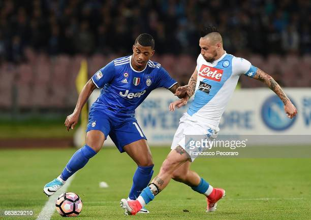 Player of Napoli Marek Hamsik vies with Juventus FC player Mario Lemina during the Serie A match between SSC Napoli and Juventus FC at Stadio San...
