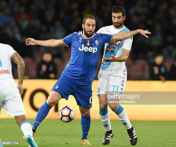 Player of Napoli Raul Albiol vies with Juventus FC player Gonzalo Higuain during the Serie A match between SSC Napoli and Juventus FC at Stadio San...