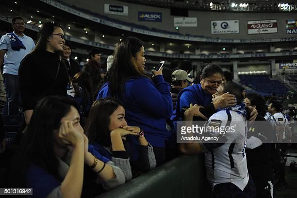 Player of Panasonic Impulse David Motu celebrates with his family after winning the Japan X Bowl between Panasonic Impulse and Fujitsu Frontiers at...
