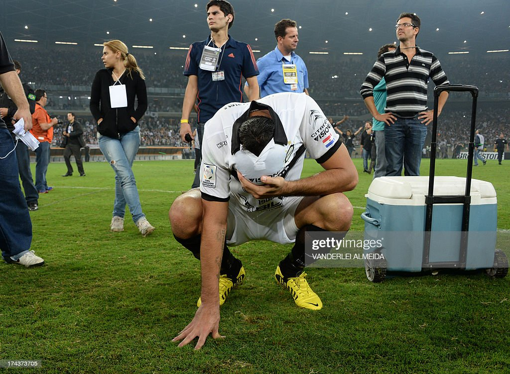 A player of Paraguayan Olimpia reacts in dejection after losing their Libertadores Cup second leg final football match shoot-out against Brazilian Atletico Mineiro at the Mineirao stadium in Belo Horizonte, Brazil on July 24, 2013. Atletico Mineiro won by 4-3 after a penalty shoot-out.