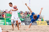Player of Rostocker Robben and Player of BeachKick Berlin compete for the ball during the round of German Beachsoccer Championship 2015 on August 15...