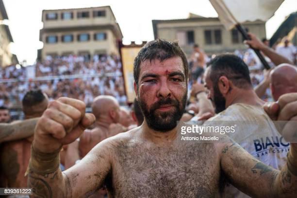 A player of Santo Spirito Bianchi celebrate the victory of the final match against Santa Maria Novella Rossi team into the La Santa Croce square...