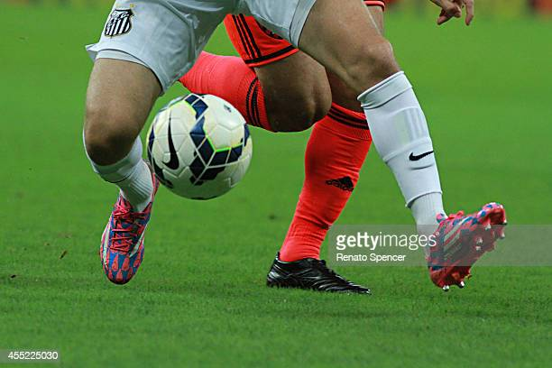 Player of Sport Recife battles for the ball with player of Santos during the Brasileirao Series A 2014 match between Sport Recife and Santos at Arena...