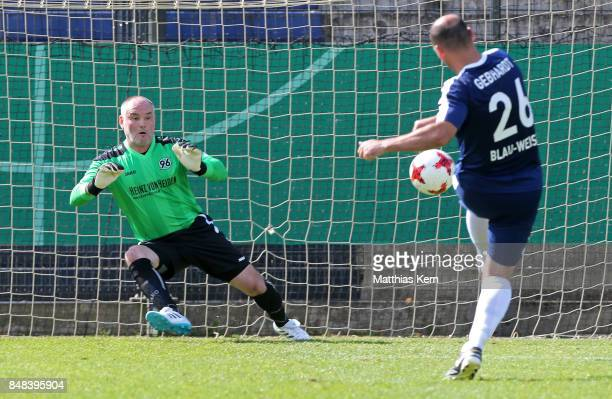 A player of SpVg Blau Weiss 1890 shoots a penalty during the half final match between SpVg Blau Weiss 1890 and Hannover 96 during the DFB over 40 and...