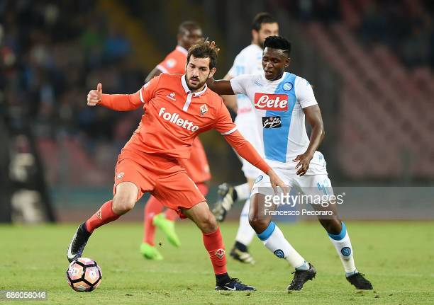 Player of SSC Napoli Amadou Diawara vies with ACF Fiorentina player Riccardo Saponara during the Serie A match between SSC Napoli and ACF Fiorentina...