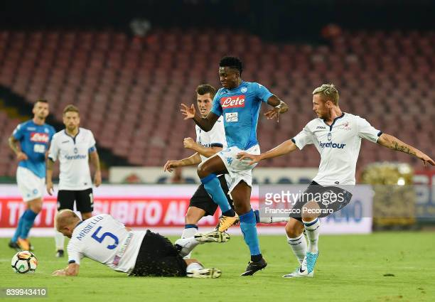 Player of SSC Napoli Amadou Diawara vies with Atalanta BC players Jasmin Kurtic and Andrea Masiello during the Serie A match between SSC Napoli and...