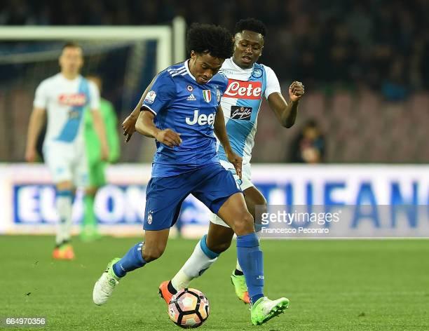 Player of SSC Napoli Amadou Diawara vies with Juventus FC player Juan Cuadrado during the TIM Cup match between SSC Napoli and Juventus FC at Stadio...