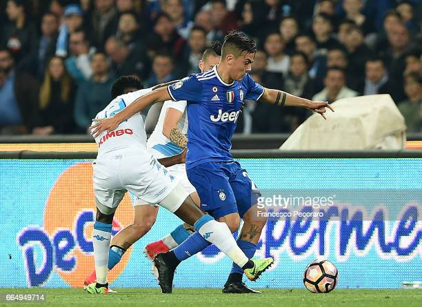 Player of SSC Napoli Amadou Diawara vies with Juventus FC player Paulo Dybala during the TIM Cup match between SSC Napoli and Juventus FC at Stadio...
