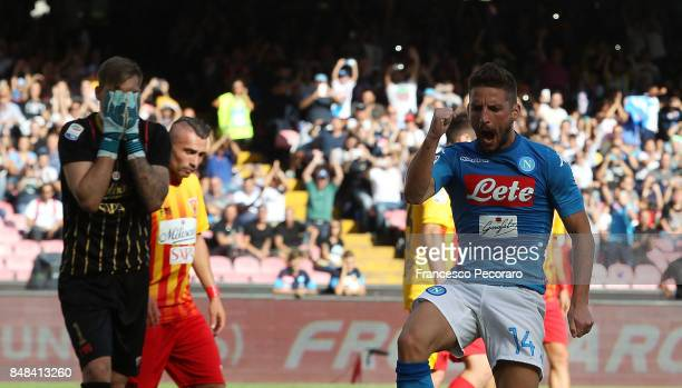 Player of SSC Napoli Dries Mertens celebrates after scoring the 60 goal beside the disappointment of the players of Benevento Calcio during the Serie...