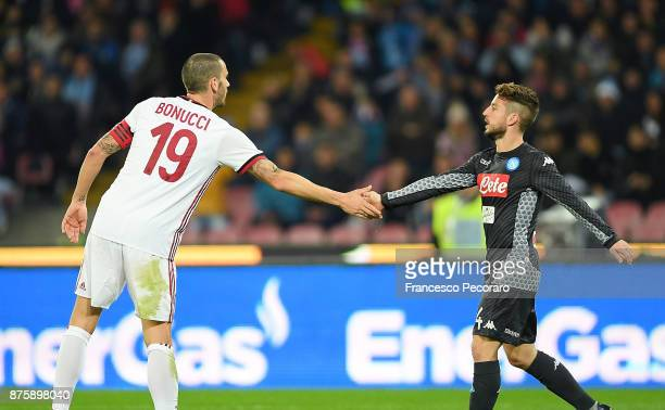 Player of SSC Napoli Dries Mertens shaking hands with AC Milan player Leonardo Bonucci during the Serie A match between SSC Napoli and AC Milan at...