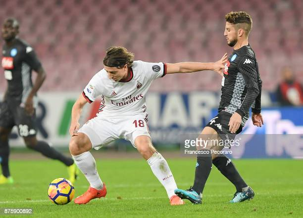 Player of SSC Napoli Dries Mertens vies with AC Milan player Riccardo Montolivo during the Serie A match between SSC Napoli and AC Milan at Stadio...
