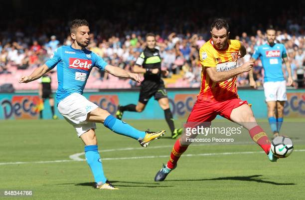 Player of SSC Napoli Dries Mertens vies with Benevento Calcio player Fabio Lucioni during the Serie A match between SSC Napoli and Benevento Calcio...