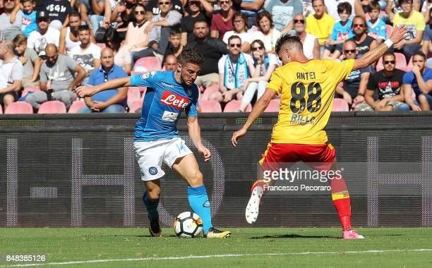 Player of SSC Napoli Dries Mertens vies with Benevento Calcio player Luca Antei during the Serie A match between SSC Napoli and Benevento Calcio at...