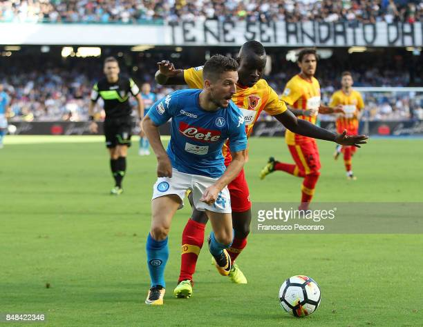Player of SSC Napoli Dries Mertens vies with Benevento Calcio player Raman Chibsah during the Serie A match between SSC Napoli and Benevento Calcio...