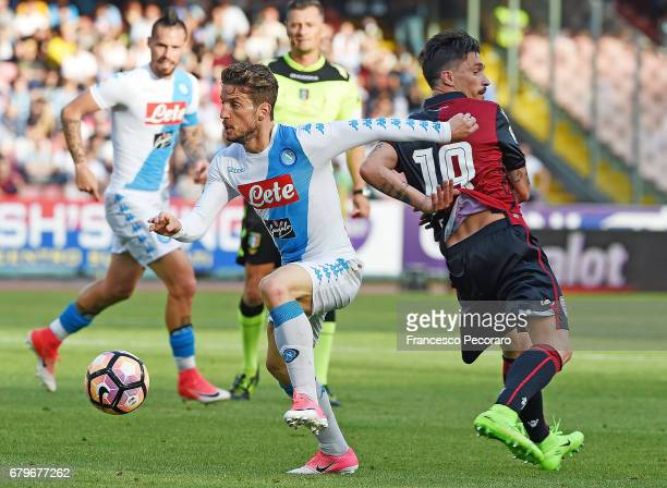 Player of SSC Napoli Dries Mertens vies with Cagliari Calcio player Fabio Pisacane during the Serie A match between SSC Napoli and Cagliari Calcio at...