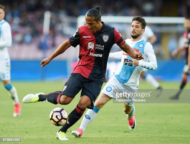 Player of SSC Napoli Dries Mertens vies with Cagliari Calcio player Bruno Alves during the Serie A match between SSC Napoli and Cagliari Calcio at...