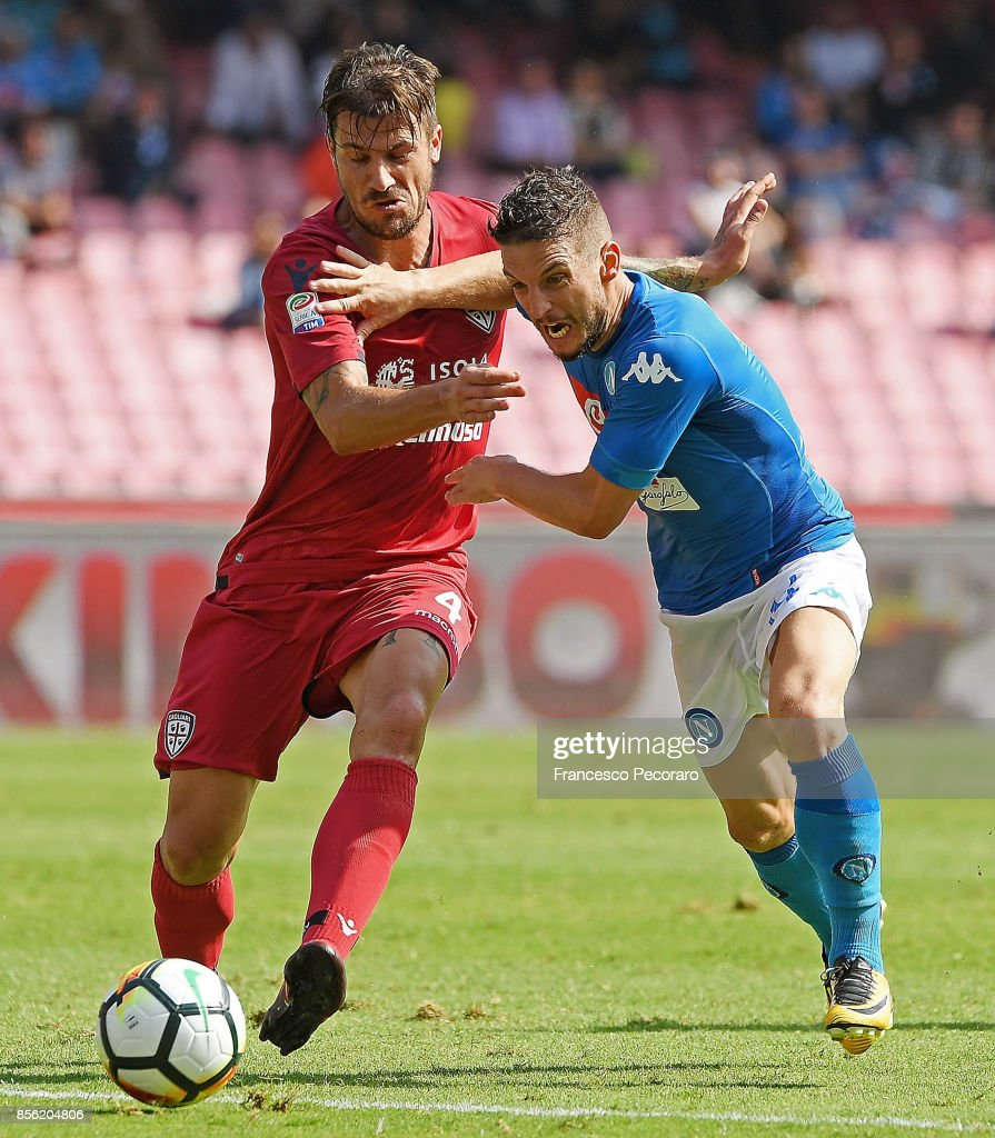 Player of SSC Napoli Dries Mertens vies with Cagliari Calcio player Daniele Dessena during the Serie A match between SSC Napoli and Cagliari Calcio at Stadio San Paolo on October 1, 2017 in Naples, Italy.