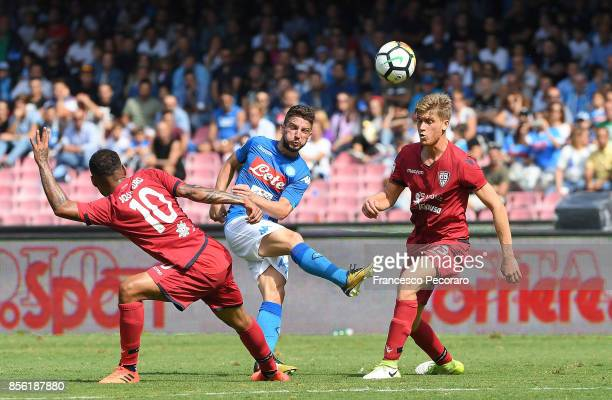 Player of SSC Napoli Dries Mertens vies with Cagliari Calcio players Joao Pedro and Filippo Romagna during the Serie A match between SSC Napoli and...