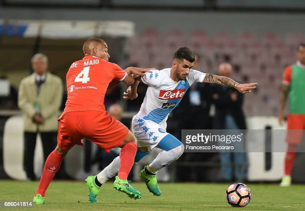 Player of SSC Napoli Elseid Hysaj vies with ACF Fiorentina player Sebastien De Maio during the Serie A match between SSC Napoli and ACF Fiorentina at...