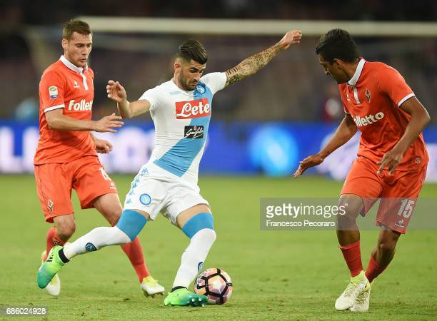 Player of SSC Napoli Elseid Hysaj vies with ACF Fiorentina players Maximiliano Olivera and Sebastian Cristoforo during the Serie A match between SSC...
