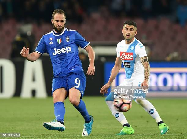 Player of SSC Napoli Elseid Hysaj vies with Juventus FC player Gonzalo Higuain during the TIM Cup match between SSC Napoli and Juventus FC at Stadio...