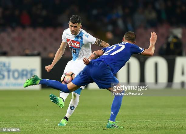 Player of SSC Napoli Elseid Hysaj vies with Juventus FC player Stefano Sturaro during the TIM Cup match between SSC Napoli and Juventus FC at Stadio...