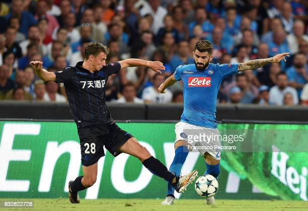 Player of SSC Napoli Elseid Hysaj vies with OGC Nice player Olivier Boscagli during the UEFA Champions League Qualifying PlayOffs Round First Leg...