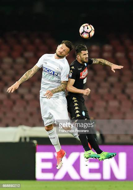Player of SSC Napoli Elseid Hysaj vies with Udinese Calcio player Cyril Thereau during the Serie A match between SSC Napoli and Udinese Calcio at...
