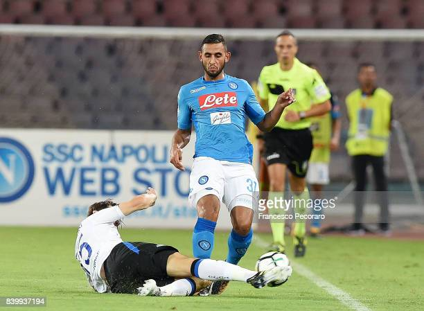 Player of SSC Napoli Faouzi Ghoulam vies with Atalanta BC player Marten de Roon during the Serie A match between SSC Napoli and Atalanta BC at Stadio...