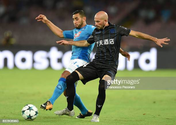 Player of SSC Napoli Faouzi Ghoulam vies with OGC Nice player Christophe Jallet during the UEFA Champions League Qualifying PlayOffs Round First Leg...