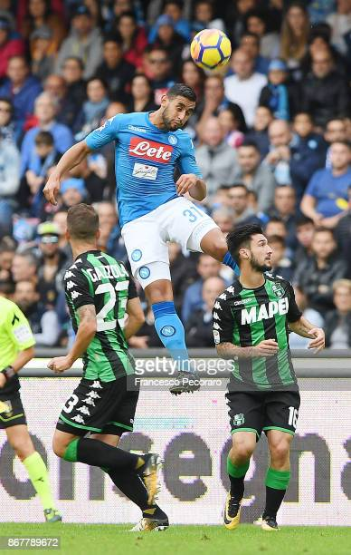 Player of SSC Napoli Faouzi Ghoulam vies with US Sassuolo players Matteo Politano and Marcello Gazzola during the Serie A match between SSC Napoli...