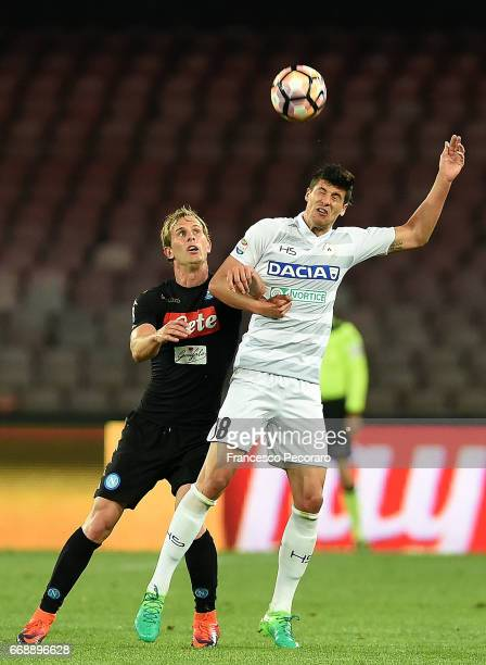 Player of SSC Napoli Ivan Strinic vies with Udinese Calcio player Stipe Perica during the Serie A match between SSC Napoli and Udinese Calcio at...