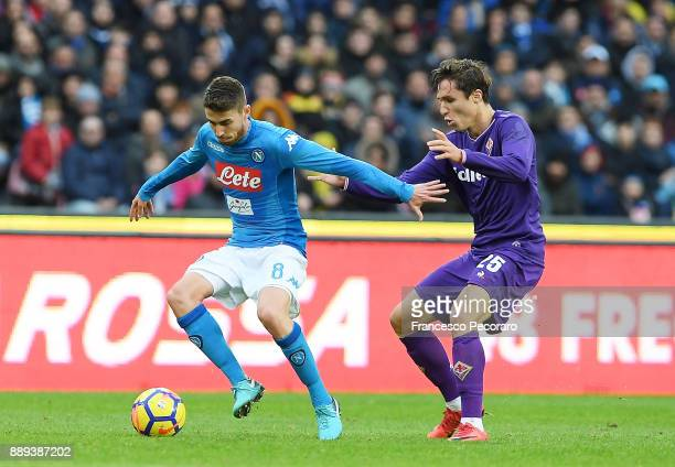 Player of SSC Napoli Jorginho vies with ACF Fiorentina player Federico Chiesa during the Serie A match between SSC Napoli and ACF Fiorentina at...